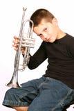 Niño que presenta con la trompeta Imágenes de archivo libres de regalías