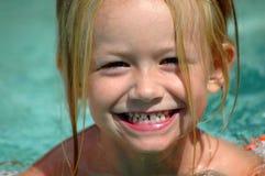 Niño que ríe nerviosamente Fotografía de archivo libre de regalías