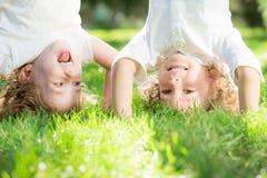 Niño que se coloca upside-down Foto de archivo libre de regalías