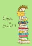 Niño que se sienta en una pila de libros y de lectura Imagen de archivo libre de regalías