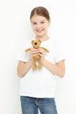 Niño que sostiene el juguete Fotos de archivo