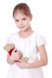 Niño que sostiene el oso de peluche Fotos de archivo libres de regalías