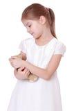 Niño que sostiene el oso de peluche Imagen de archivo