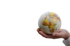 Niño que sostiene un globo Imagen de archivo