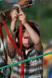 Niño que sube en patio de la aventura Imagen de archivo libre de regalías