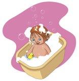 Niño que toma un baño Imagenes de archivo