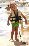 Niño que usa al salvavidas Fotografía de archivo