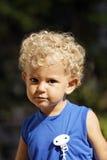 Niño rubio con el bloqueo Foto de archivo