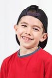 Niño sonriente en casquillo Imagen de archivo
