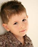 Niño triste, aburrido, que soña despierto Fotos de archivo libres de regalías
