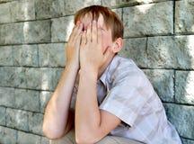 Niño triste al aire libre Fotografía de archivo