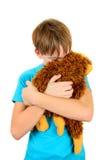 Niño triste con el juguete de la felpa Fotografía de archivo