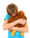 Niño triste con el juguete de la felpa Imagenes de archivo