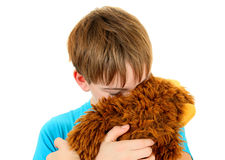 Niño triste con el juguete de la felpa Fotografía de archivo libre de regalías