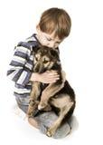 Niño triste con el perrito Imagen de archivo libre de regalías