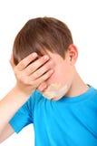 Niño triste con la boca sellada Fotos de archivo libres de regalías
