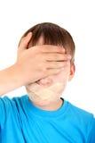 Niño triste con la boca sellada Fotos de archivo