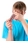 Niño triste con las píldoras Fotografía de archivo