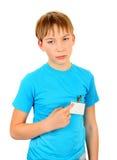 Niño triste con una insignia Fotografía de archivo libre de regalías