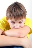 Niño triste en el hogar Imagenes de archivo