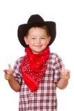 Niño vestido encima como de jugar del vaquero Imagenes de archivo