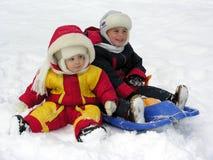 Niño y bebé. invierno Foto de archivo libre de regalías