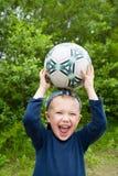 Niño y bola Imagen de archivo