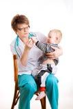 Niño y doctor Foto de archivo