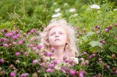 Niño y flores Fotos de archivo