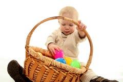 Niño y huevos de Pascua Imagenes de archivo