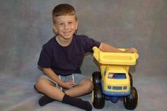 Niño y juguete fotografía de archivo libre de regalías