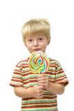 Niño y lollipop Fotografía de archivo