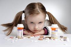 Niño y medicación Imagen de archivo libre de regalías