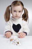 Niño y medicación Foto de archivo