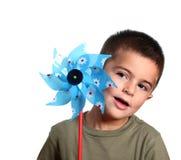 Niño y molino de viento Fotografía de archivo