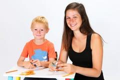 Niño y niñera Imágenes de archivo libres de regalías