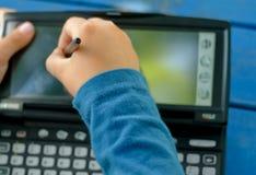 Niño y PDA Imagen de archivo libre de regalías