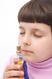 Niño y perfume Imagen de archivo