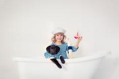 Niño y perro Foto de archivo