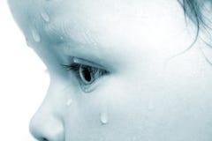 Niño y rasgón Imagen de archivo