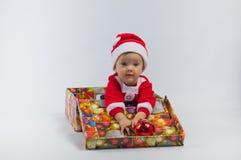 Niño y regalo Imagen de archivo