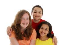 Niños adolescentes en el fondo blanco Fotografía de archivo libre de regalías