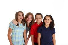 Niños adolescentes en el fondo blanco Imagen de archivo