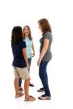 Niños adolescentes en el fondo blanco Imagen de archivo libre de regalías