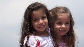 Niños adorables de las muchachas lindas almacen de video