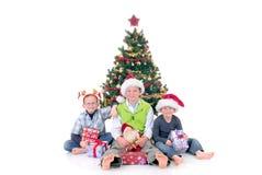Niños alrededor de Navidad tres Fotografía de archivo libre de regalías
