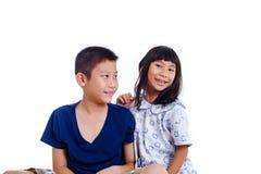 Niños asiáticos felices aislados en blanco Fotografía de archivo libre de regalías