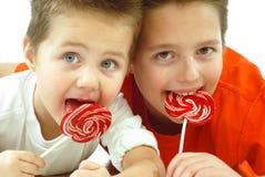 Niños con el caramelo Foto de archivo libre de regalías