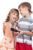 Niños con el micrófono Fotografía de archivo libre de regalías