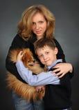 Niños con el perro Imagenes de archivo